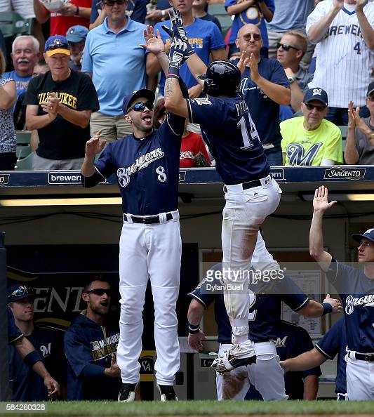 Ryan Braun congratulates Hernan Perez of the Milwaukee Brewers after Perez hit a home run in the third inning against the Arizona Diamondbacks at...
