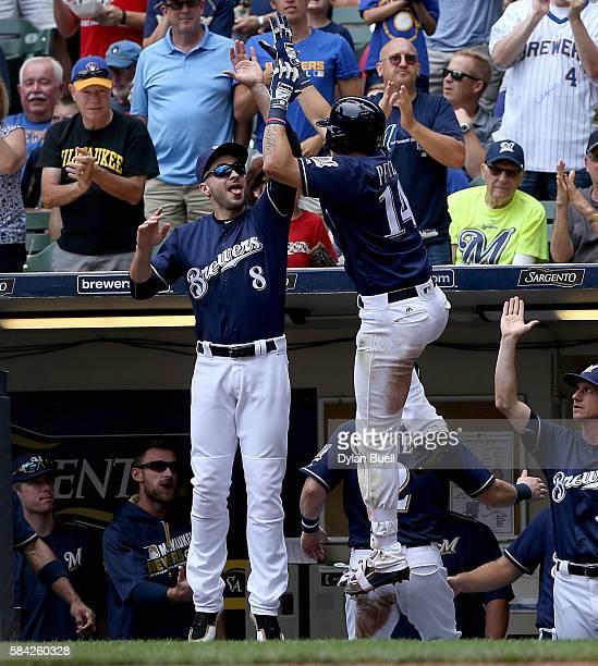 Ryan Braun congratulates Hernan Perez of the Milwaukee Brewers after Perez hit a home run in the third inning against the Arizona Diamondbacks at...