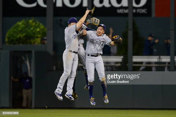 Ryan Braun Keon Broxton and Hernan Perez of the Milwaukee Brewers celebrate a 63 win over the Colorado Rockies at Coors Field on August 19 2017 in...