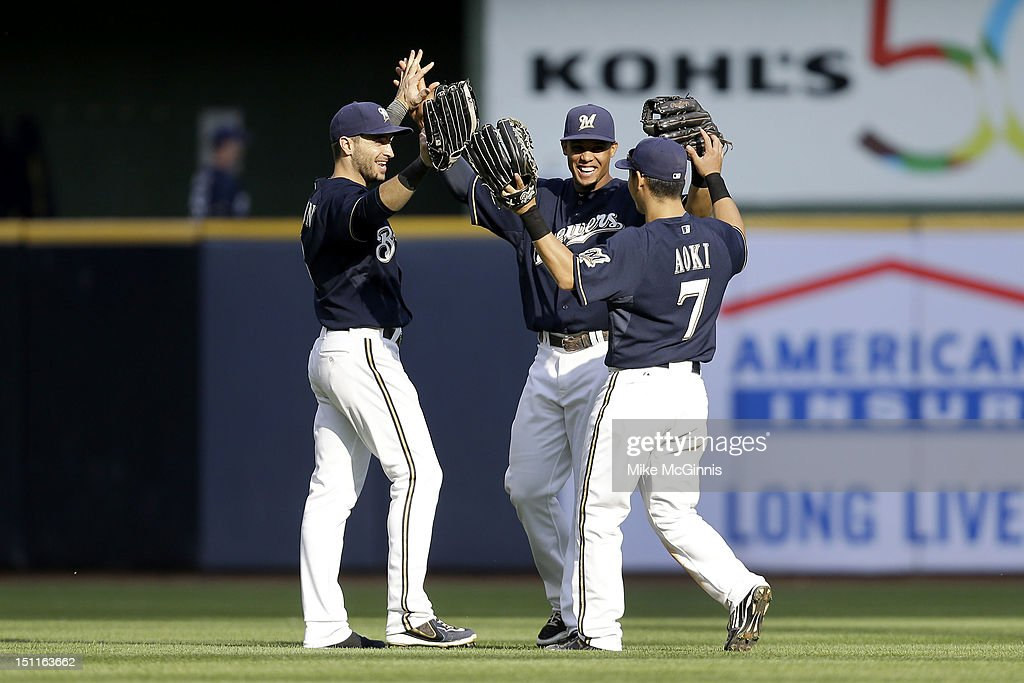 Ryan Braun #8, <a gi-track='captionPersonalityLinkClicked' href=/galleries/search?phrase=Norichika+Aoki&family=editorial&specificpeople=850957 ng-click='$event.stopPropagation()'>Norichika Aoki</a> #7 and Carlos Gomez #27 of the Milwaukee Brewers celebrate after the 12-8 win over the Pittsburgh Pirates at Miller Park on September 02, 2012 in Milwaukee, Wisconsin.