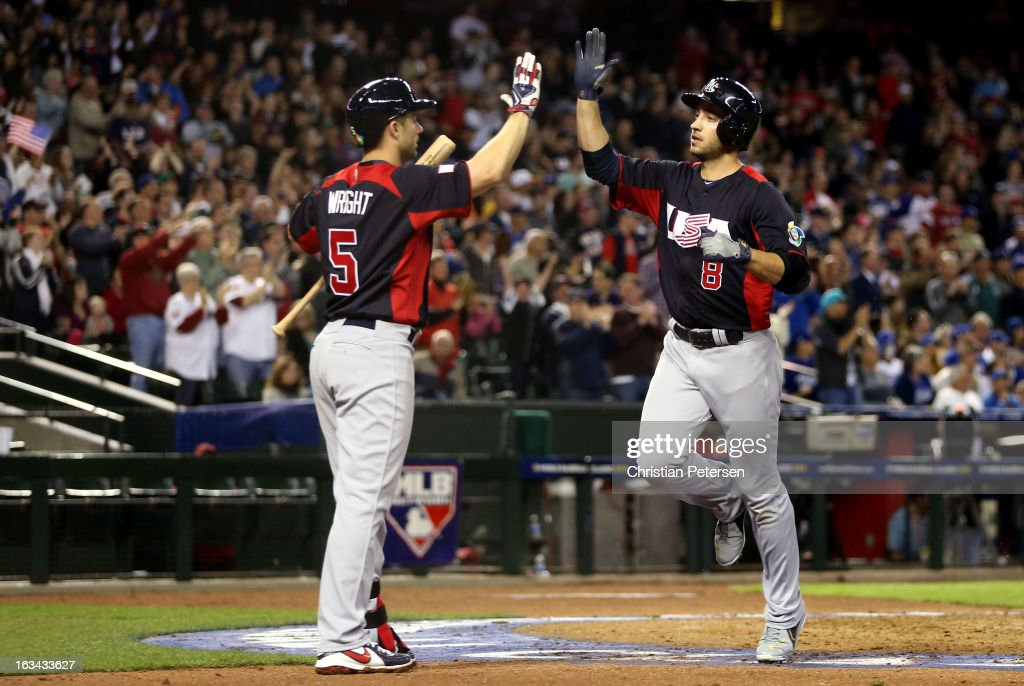 Ryan Braun #8 of Team USA celebrates with teammate <a gi-track='captionPersonalityLinkClicked' href=/galleries/search?phrase=David+Wright+-+Baseball+Player&family=editorial&specificpeople=209172 ng-click='$event.stopPropagation()'>David Wright</a> #5 after scoring a run in the fourth inning against of Italy during the World Baseball Classic First Round Group D game at Chase Field on March 9, 2013 in Phoenix, Arizona.