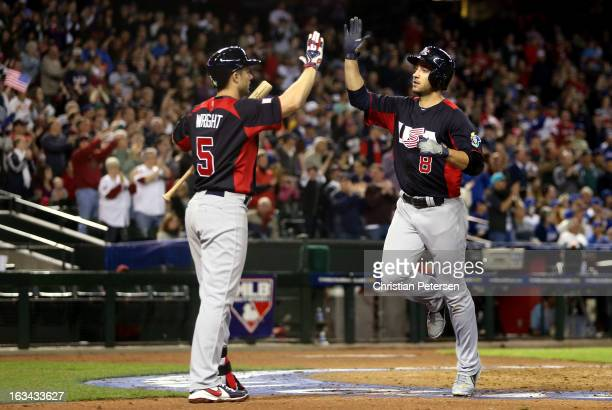 Ryan Braun of Team USA celebrates with teammate David Wright after scoring a run in the fourth inning against of Italy during the World Baseball...