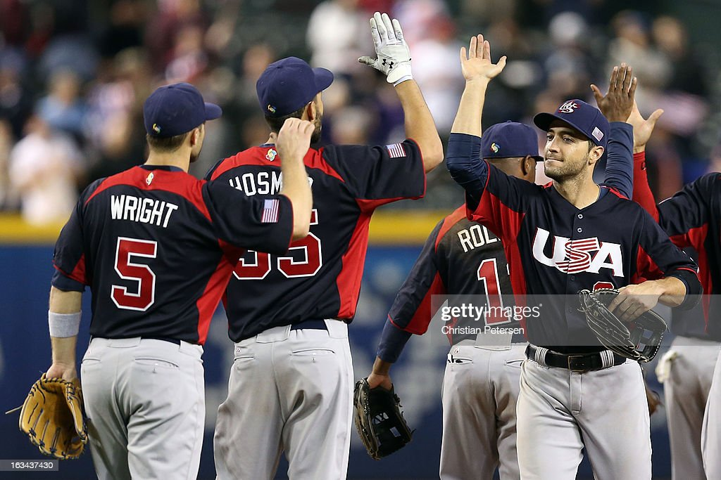 Ryan Braun #8 of Team USA celebrates with teammates <a gi-track='captionPersonalityLinkClicked' href=/galleries/search?phrase=Eric+Hosmer&family=editorial&specificpeople=7091345 ng-click='$event.stopPropagation()'>Eric Hosmer</a> #35 and <a gi-track='captionPersonalityLinkClicked' href=/galleries/search?phrase=David+Wright+-+Baseball+Player&family=editorial&specificpeople=209172 ng-click='$event.stopPropagation()'>David Wright</a> #5 after defeating Team Italy 6 to 2 after the World Baseball Classic First Round Group D game against team Italy at Chase Field on March 9, 2013 in Phoenix, Arizona.