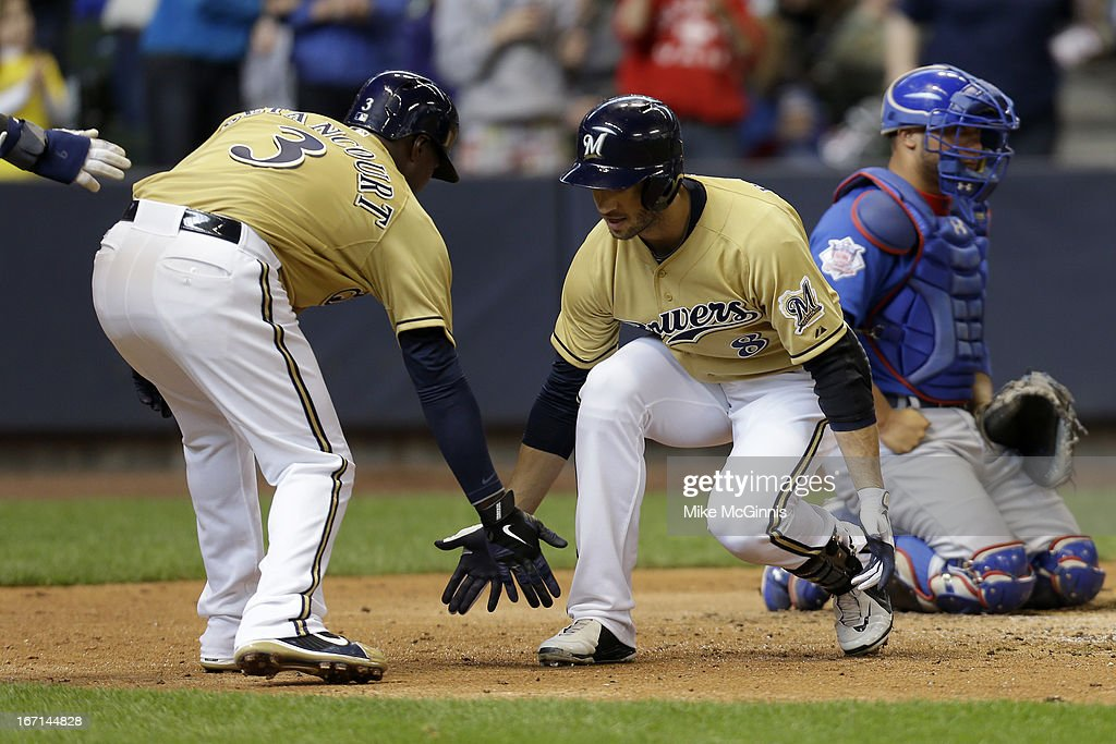 Ryan Braun #8 of the Milwaukee Brewers celebrates after hitting a three run homer in the bottom of the fifth inning scoring Jean Segura and <a gi-track='captionPersonalityLinkClicked' href=/galleries/search?phrase=Yuniesky+Betancourt&family=editorial&specificpeople=550744 ng-click='$event.stopPropagation()'>Yuniesky Betancourt</a> against the Chicago Cubs at Miller Park on April 21, 2013 in Milwaukee, Wisconsin.