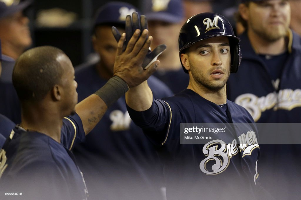 Ryan Braun #8 of the Milwaukee Brewers celebrates after reaching home on a double hit by Aramis Ramirez in the bottom of the sixth inning against the Texas Rangers at Miller Park on May 08, 2013 in Milwaukee, Wisconsin.