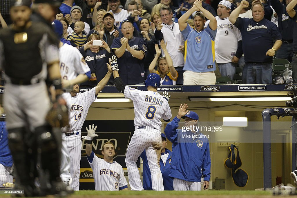 Ryan Braun #8 of the Milwaukee Brewers celebrates after reaching on a double hit by Jonathan Lucroy in the bottom of the eighth inning against the Pittsburgh Pirates at Miller Park on April 12, 2014 in Milwaukee, Wisconsin.