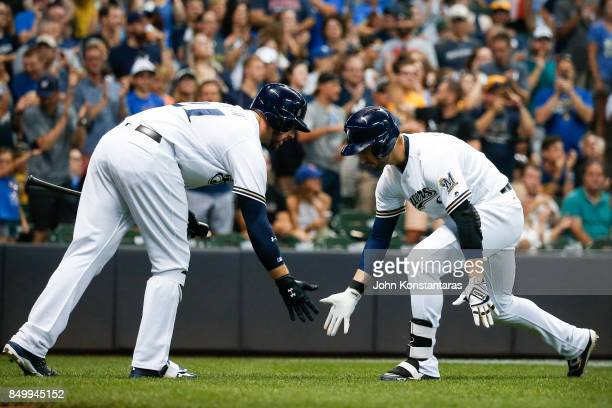 Ryan Braun of the Milwaukee Brewers celebrates his home run with Travis Shaw during the sixth inning against the Miami Marlins at Miller Park on...