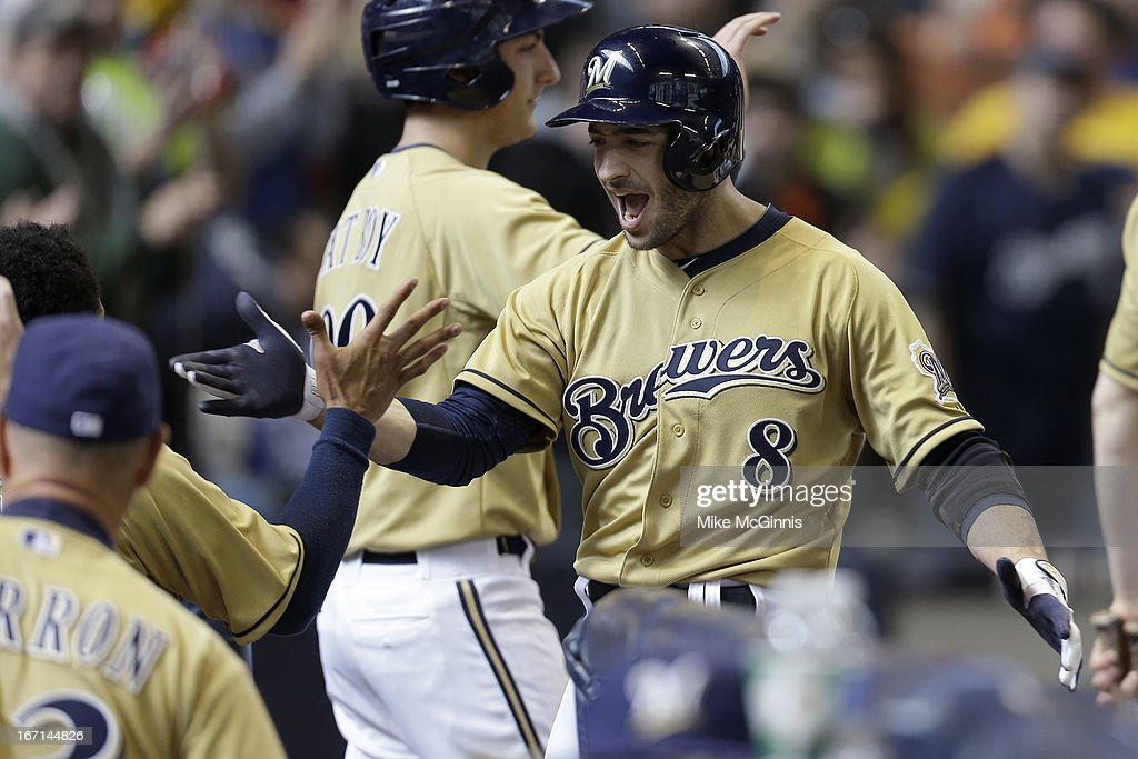 Ryan Braun #8 of the Milwaukee Brewers celebrates outside the dugout after hitting a three run homer in the bottom of the fifth inning scoring Jean Segura and Yuniesky Betancourt against the Chicago Cubs at Miller Park on April 21, 2013 in Milwaukee, Wisconsin.