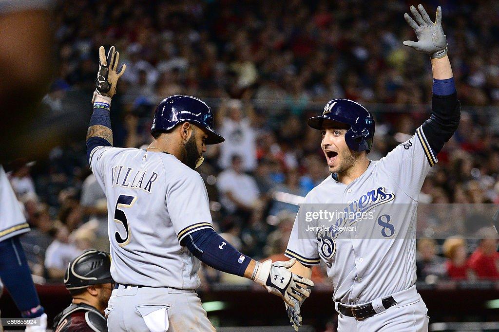Ryan Braun of the Milwaukee Brewers celebrates with Jonathan Villar after Braun hit a three run home run against the Arizona Diamondbacks during the...