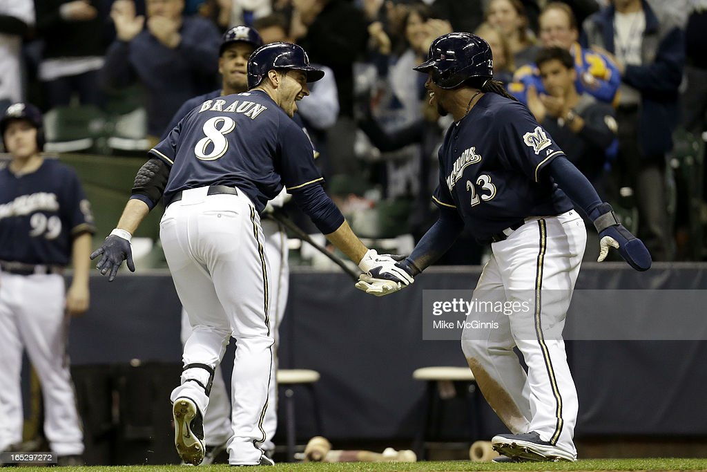 Ryan Braun #8 of the Milwaukee Brewers celebrates with <a gi-track='captionPersonalityLinkClicked' href=/galleries/search?phrase=Rickie+Weeks&family=editorial&specificpeople=550245 ng-click='$event.stopPropagation()'>Rickie Weeks</a> #23 after hitting a two-run homer in the bottom of the third inning against the Colorado Rockies at Miller Park on April 2, 2013 in Milwaukee, Wisconsin.