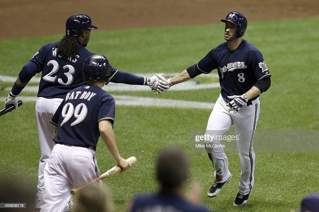 Ryan Braun #8 of the Milwaukee Brewers celebrates with <a gi-track='captionPersonalityLinkClicked' href=/galleries/search?phrase=Rickie+Weeks&family=editorial&specificpeople=550245 ng-click='$event.stopPropagation()'>Rickie Weeks</a> #23 after reaching home plate on a sacrifice fly hit by Khris Davis in the bottom of the third inning against the Toronto Blue Jays during the Interleague game at Miller Park on August 19, 2014 in Milwaukee, Wisconsin.