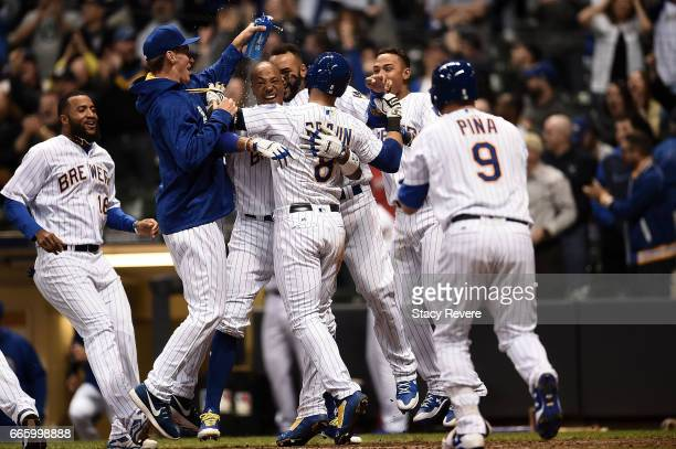 Ryan Braun of the Milwaukee Brewers celebrates with teammates after scoring the winning run on a passed ball during the eleventh inning of a game...