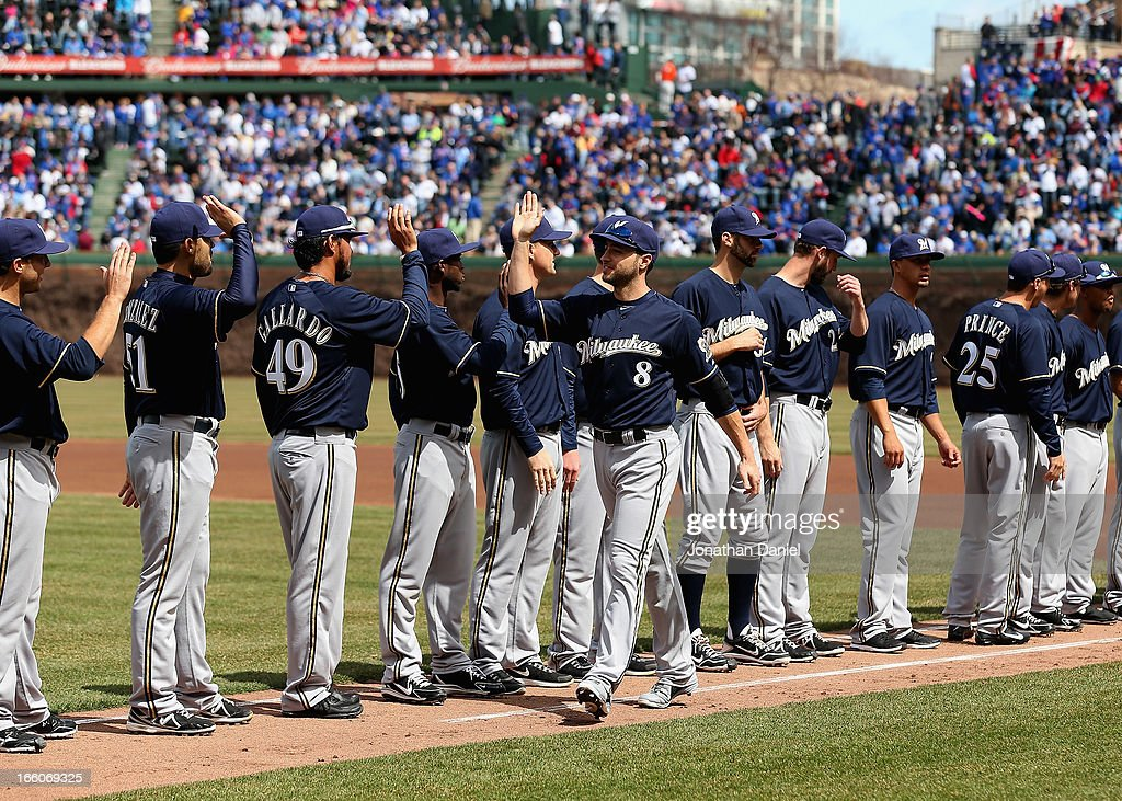 Ryan Braun #8 of the Milwaukee Brewers greets teammates during player introductions before the Opening Day game against the Chicago Cubs at Wrigley Field on April 8, 2013 in Chicago, Illinois.