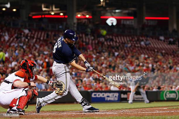 Ryan Braun of the Milwaukee Brewers hits a double in the third inning against the Cincinnati Reds during the game at Great American Ball Park on...