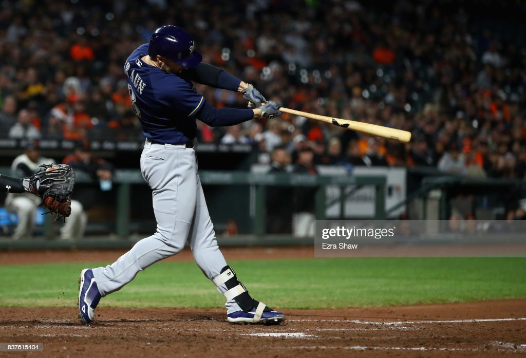 Ryan Braun #8 of the Milwaukee Brewers hits a sacrifice fly that scored Eric Thames #7 in the seventh inning against the San Francisco Giants at AT&T Park on August 22, 2017 in San Francisco, California.