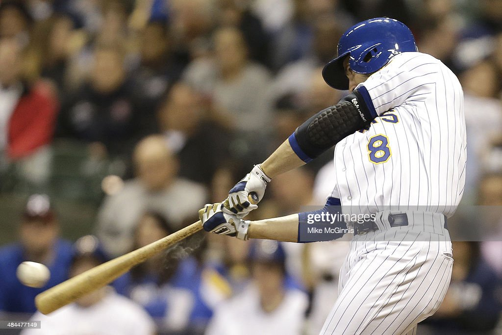 Ryan Braun #8 of the Milwaukee Brewers hits a single in the bottom of the sixth inning against the Pittsburgh Pirates at Miller Park on April 12, 2014 in Milwaukee, Wisconsin.