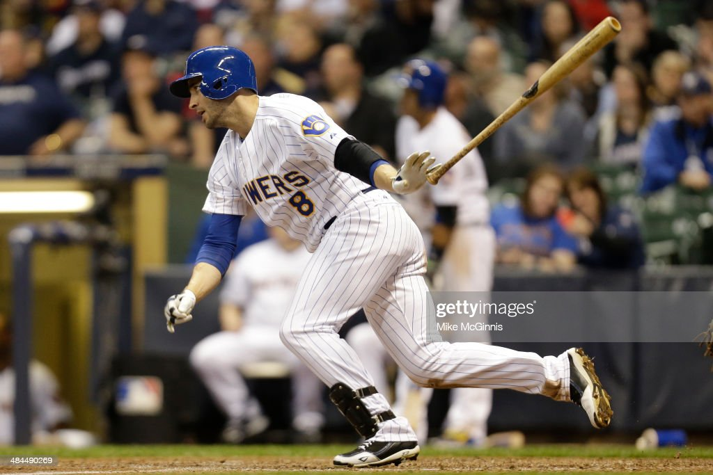 Ryan Braun #8 of the Milwaukee Brewers hits a single in the bottom of the eighth inning against the Pittsburgh Pirates at Miller Park on April 12, 2014 in Milwaukee, Wisconsin.