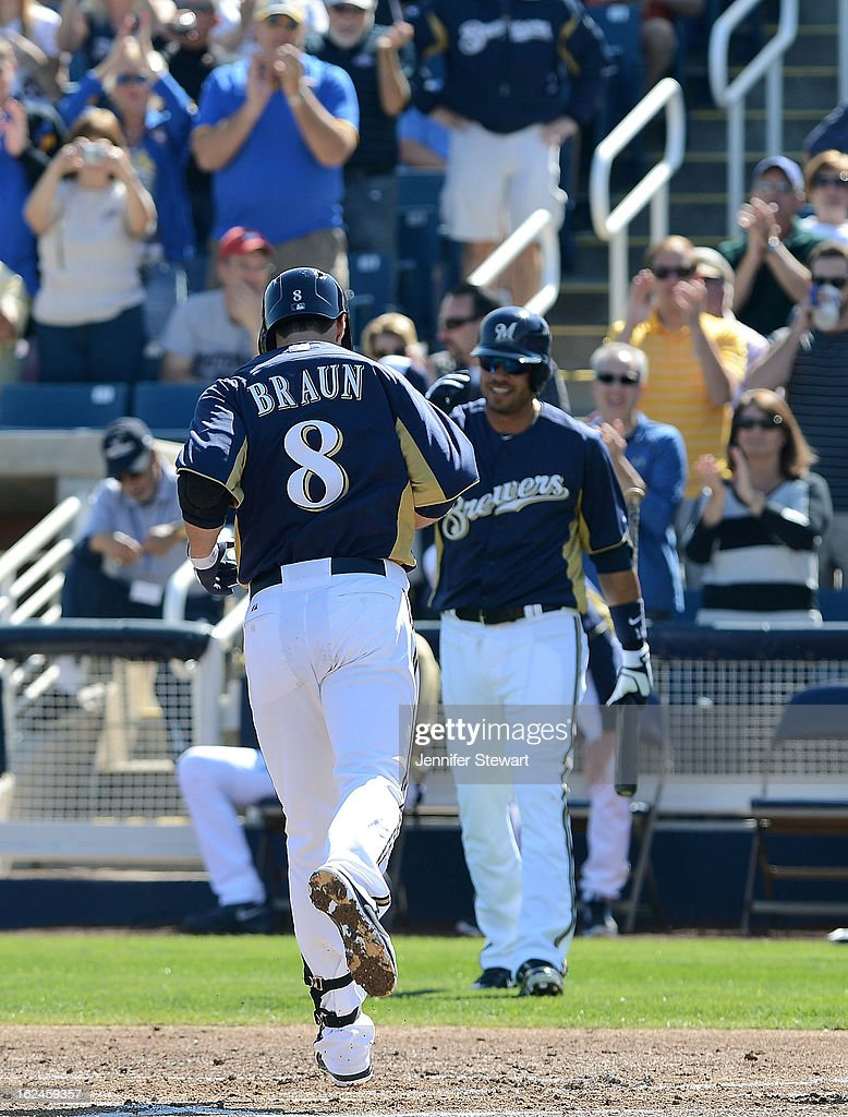Ryan Braun #8 of the Milwaukee Brewers is congratulated at home plate by teammate Aramis Ramirez #16 after hitting a solo home run against the Oakland Athletics in the first inning during the spring training game at Maryvale Baseball Park on February 23, 2013 in Phoenix, Arizona.