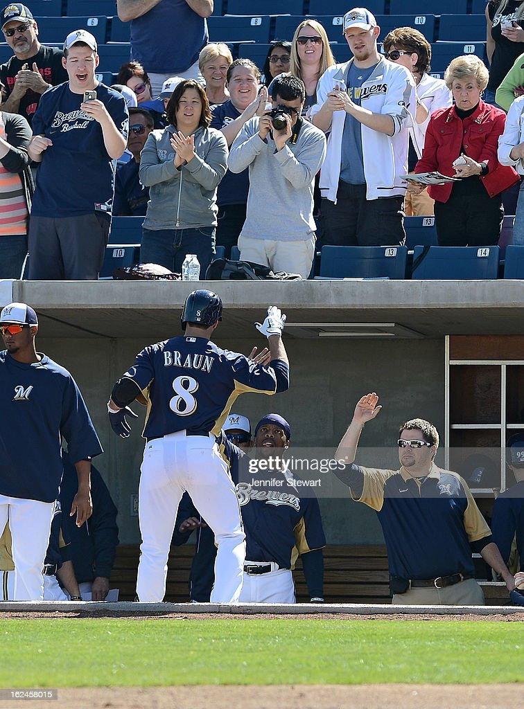 Ryan Braun #8 of the Milwaukee Brewers is congratulated by teammates after hitting a solo home run against the Oakland Athletics in the first inning during the spring training game at Maryvale Baseball Park on February 23, 2013 in Phoenix, Arizona.