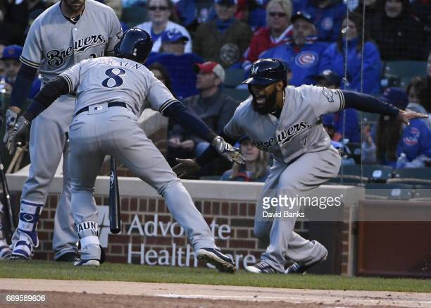Ryan Braun of the Milwaukee Brewers is greeted by Eric Thames after hitting a tworun homer during the first inning against the Chicago Cubs on April...