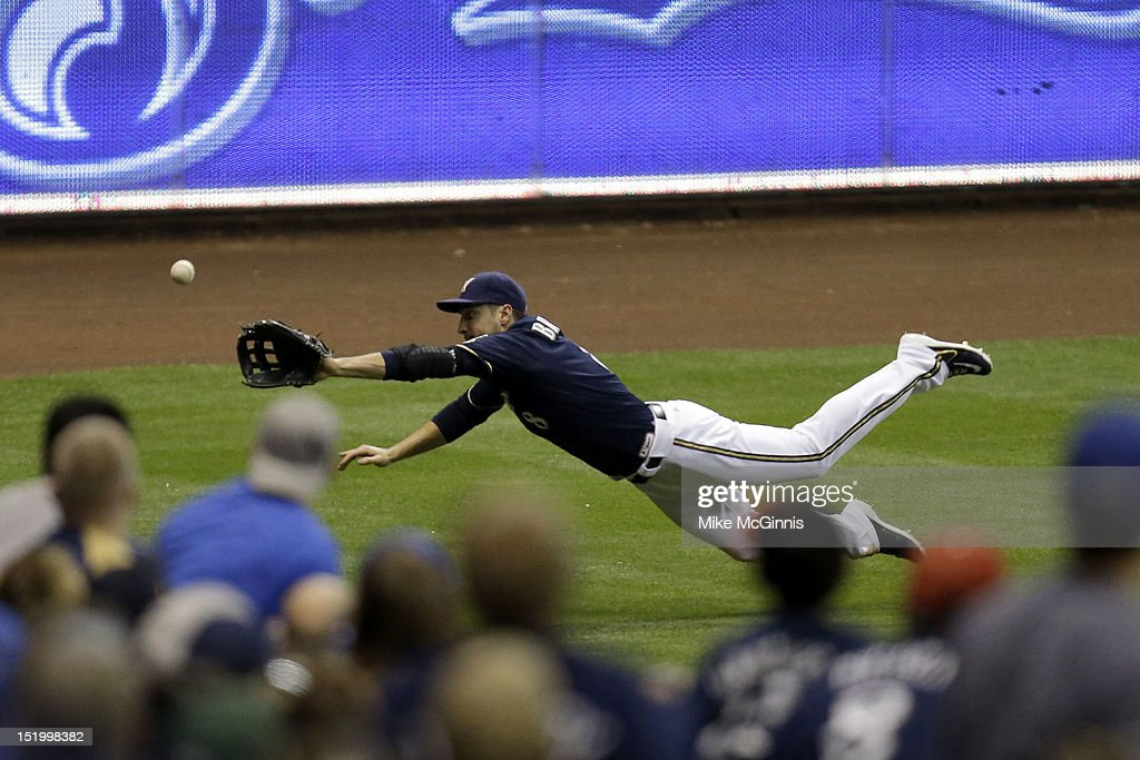 Ryan Braun #8 of the Milwaukee Brewers misses a diving catch in left field off the bat of Josh Thole of the New York Mets during top of the sixth inning at Miller Park on September 14, 2012 in Milwaukee, Wisconsin.