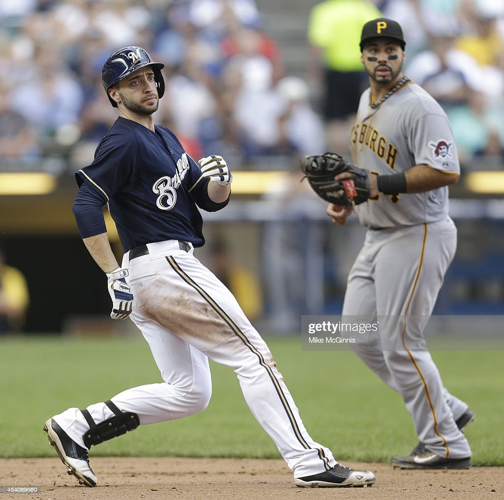 Ryan Braun #8 of the Milwaukee Brewers rounds first base after hitting a single in the bottom of the first inning against the Pittsburgh Pirates at Miller Park on August 24, 2014 in Milwaukee, Wisconsin.
