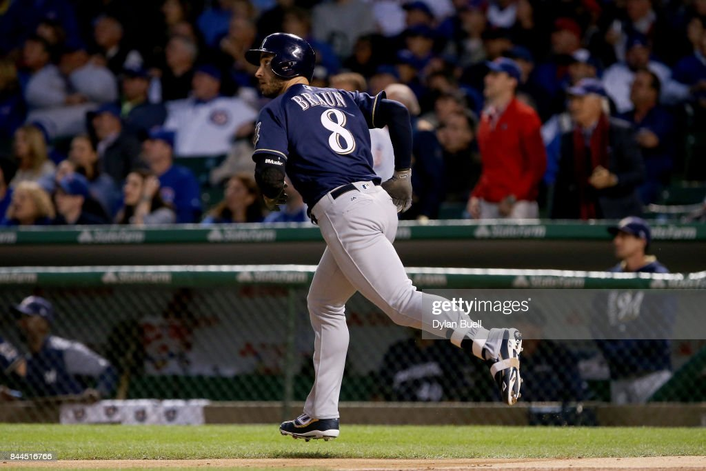 Ryan Braun #8 of the Milwaukee Brewers rounds the bases after hitting his 300th career home run in the first inning against the Chicago Cubs at Wrigley Field on September 8, 2017 in Chicago, Illinois.