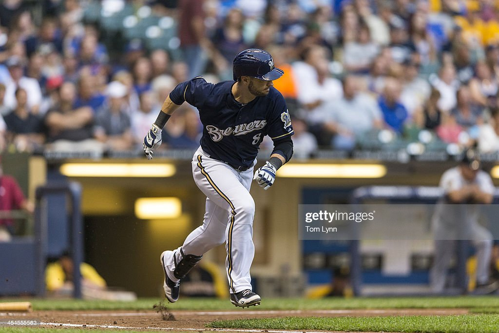 Ryan Braun #8 of the Milwaukee Brewers runs to first against the Pittsburg Pirates at Miller Park on August 23, 2014 in Milwaukee, Wisconsin.