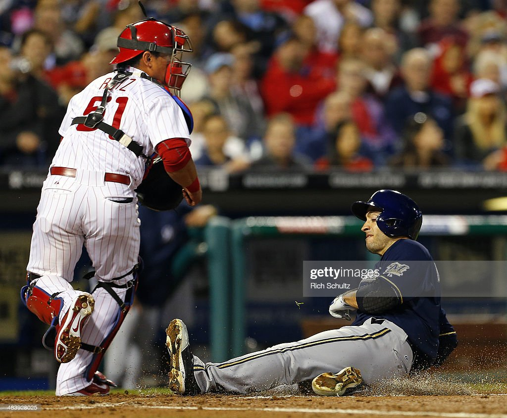 Ryan Braun of the Milwaukee Brewers scores before the throw can get to catcher Carlos Ruiz of the Philadelphia Phillies on a double by Aramis Ramirez...
