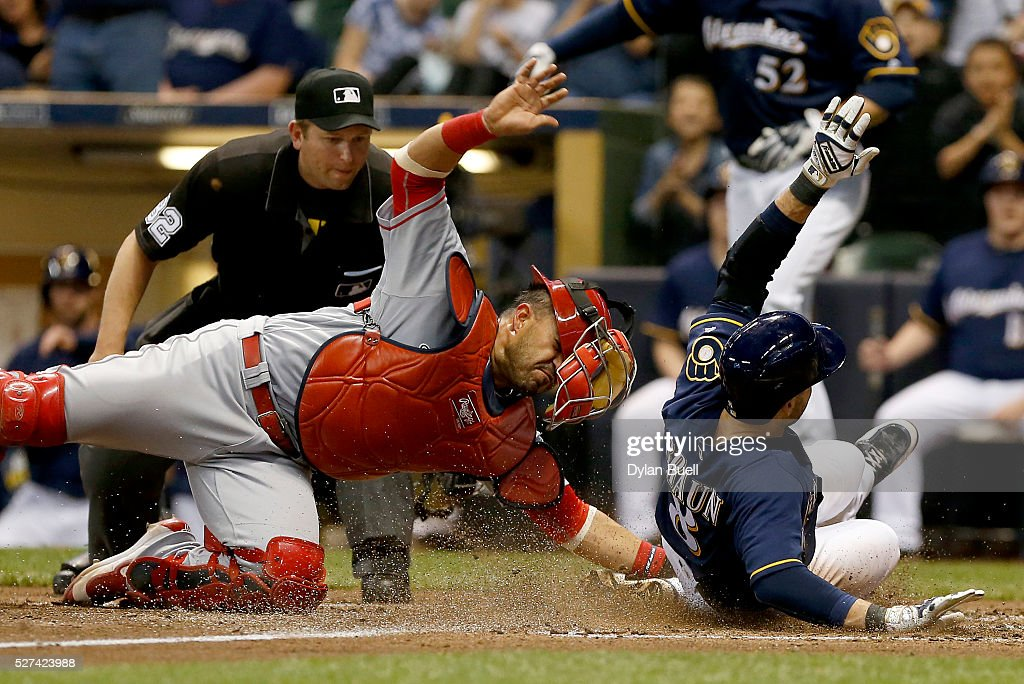 Ryan Braun of the Milwaukee Brewers slides safely into home past Geovany Soto of the Los Angeles Angels of Anaheim in the fifth inning at Miller Park...