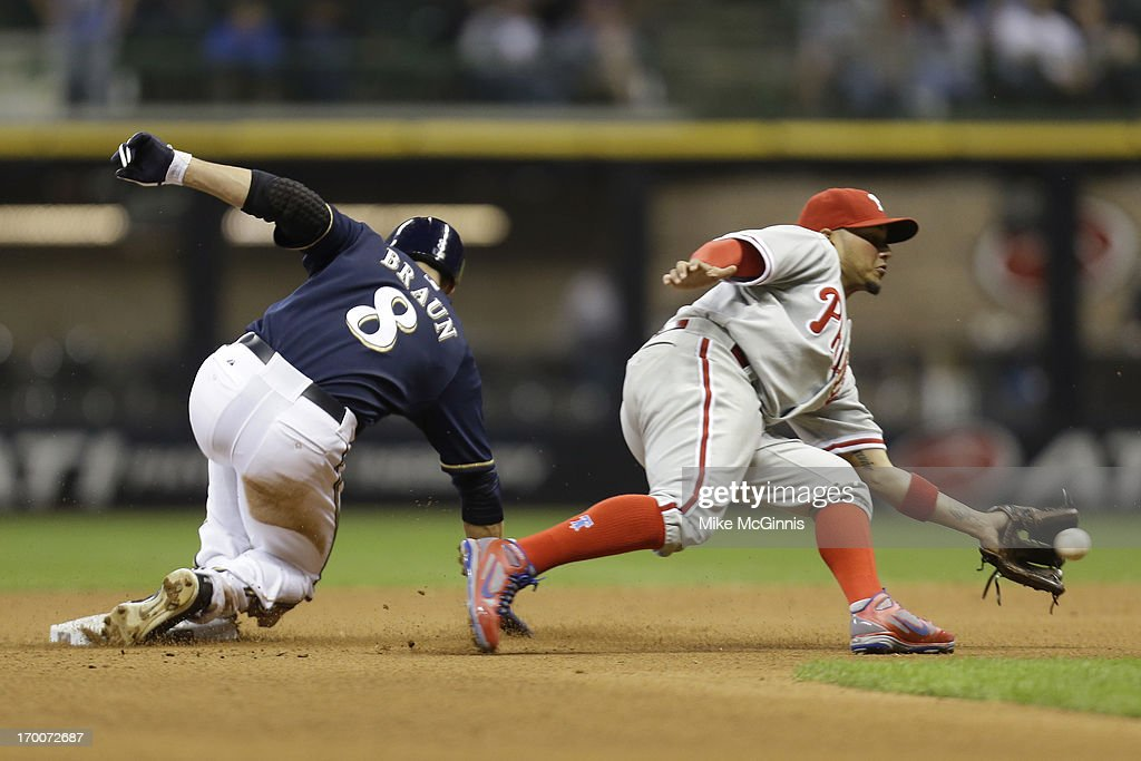 Ryan Braun #8 of the Milwaukee Brewers steals second base as Freddy Galvis #13 of the Philadelphia Phillies taks the late throw in the bottom of the eighth inning at Miller Park on June 06, 2013 in Milwaukee, Wisconsin.