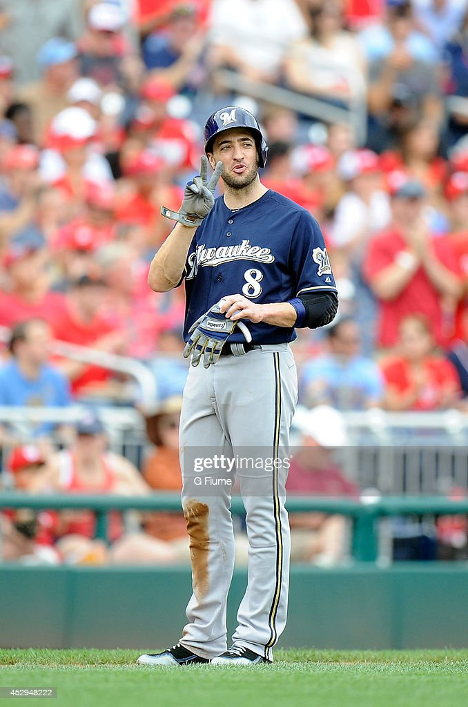 Ryan Braun #8 of the Milwaukee Brewers takes off his batting gloves during the game against the Washington Nationals at Nationals Park on July 20, 2014 in Washington, DC.