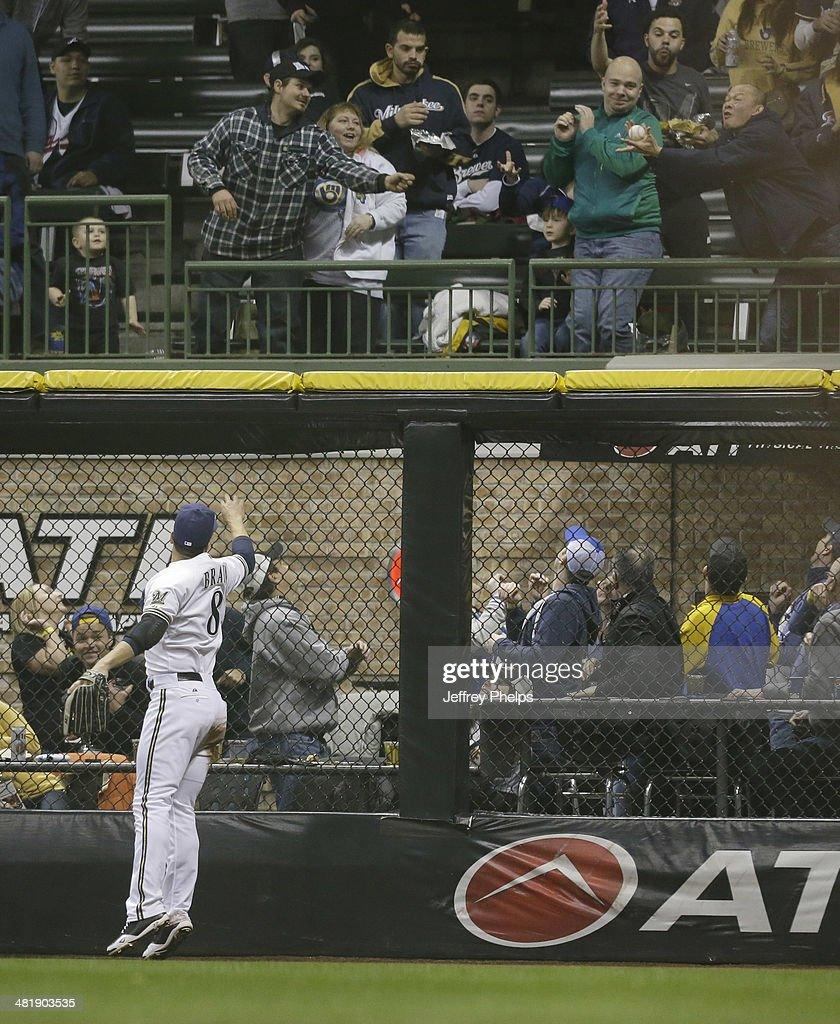 Ryan Braun #8 of the Milwaukee Brewers watches the two run home run of Atlanta Braves' Jason Heyward in the fifth inning of a game at Miller Park on April 1, 2014 in Milwaukee, Wisconsin.