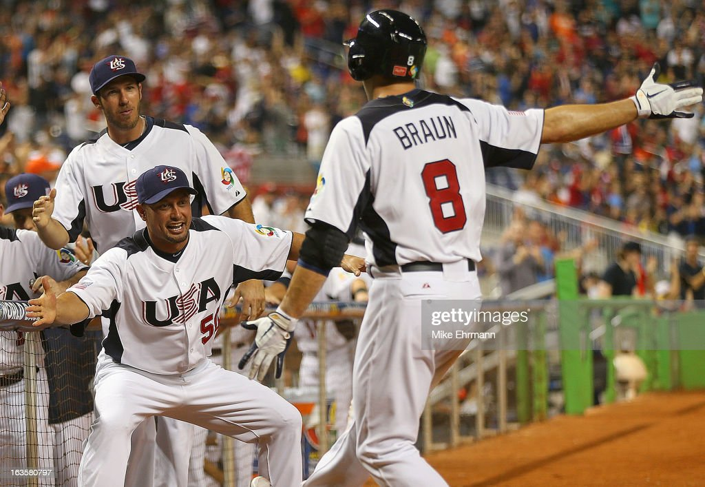 Ryan Braun #8 of the United States is congratulated by <a gi-track='captionPersonalityLinkClicked' href=/galleries/search?phrase=Shane+Victorino&family=editorial&specificpeople=576251 ng-click='$event.stopPropagation()'>Shane Victorino</a> #50 during a World Baseball Classic second round game against Puerto Rico at Marlins Park on March 12, 2013 in Miami, Florida.