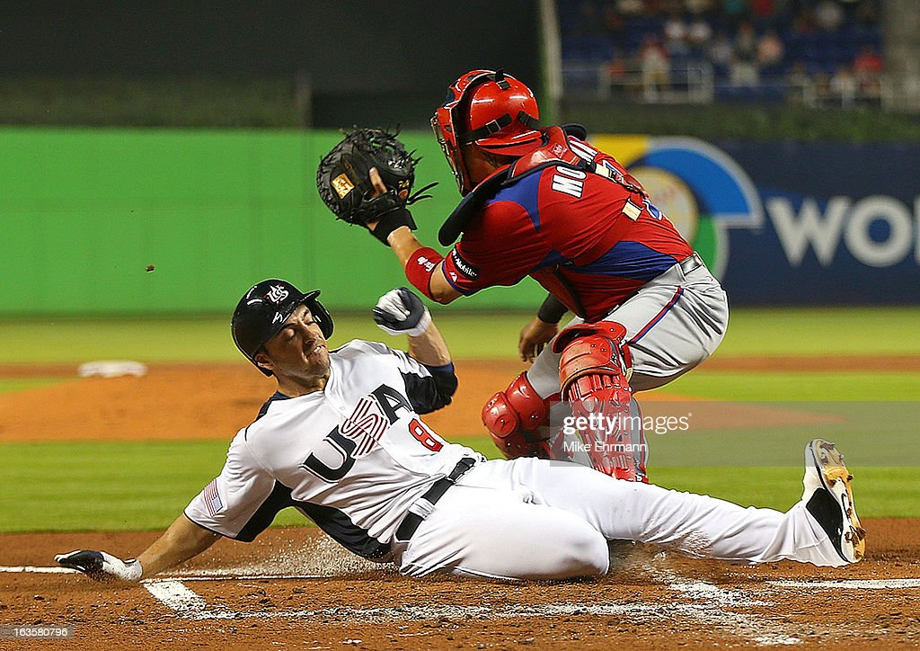 Ryan Braun #8 of the United States slides under the tag of <a gi-track='captionPersonalityLinkClicked' href=/galleries/search?phrase=Yadier+Molina&family=editorial&specificpeople=172002 ng-click='$event.stopPropagation()'>Yadier Molina</a> #4 of Puerto Rico during a World Baseball Classic second round game at Marlins Park on March 12, 2013 in Miami, Florida.