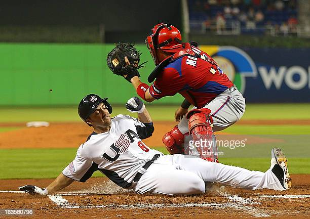 Ryan Braun of the United States slides under the tag of Yadier Molina of Puerto Rico during a World Baseball Classic second round game at Marlins...