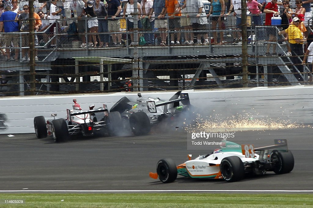 Ryan Briscoe, driver of the #26 Izod Team Penske, and Townsend Bell (right), driver of the #99 Herbalife Schmidt Pelfrey Racing, crash during the IZOD IndyCar Series Indianapolis 500 Mile Race at Indianapolis Motor Speedway on May 29, 2011 in Indianapolis, Indiana.