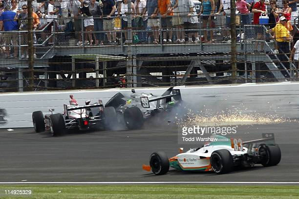 Ryan Briscoe driver of the Izod Team Penske and Townsend Bell driver of the Herbalife Schmidt Pelfrey Racing crash during the IZOD IndyCar Series...