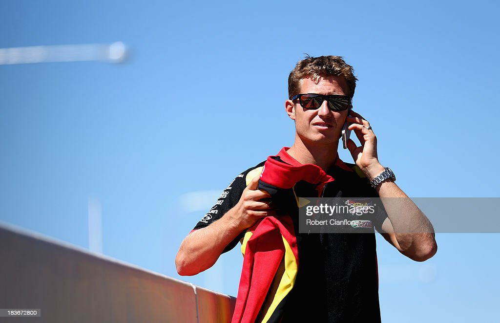 <a gi-track='captionPersonalityLinkClicked' href=/galleries/search?phrase=Ryan+Briscoe&family=editorial&specificpeople=213207 ng-click='$event.stopPropagation()'>Ryan Briscoe</a> driver of the #66 Supercheap Auto Racing Holden is seen in pit lane during previews ahead of the Bathurst 1000, which is round 11 of the V8 Supercars Championship Series at Mount Panorama on October 9, 2013 in Bathurst, Australia.
