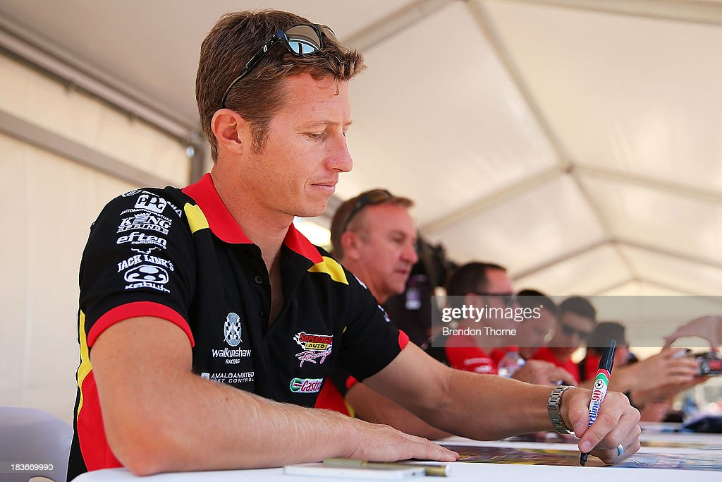 <a gi-track='captionPersonalityLinkClicked' href=/galleries/search?phrase=Ryan+Briscoe&family=editorial&specificpeople=213207 ng-click='$event.stopPropagation()'>Ryan Briscoe</a> driver of the #66 Supercheap Auto Racing Holden signs autographs at an autograph session during previews ahead of the Bathurst 1000, which is round 11 of the V8 Supercars Championship Series on October 9, 2013 in Bathurst, Australia.