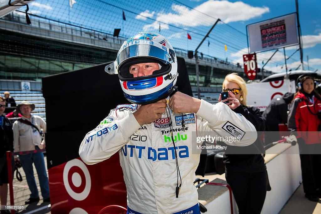 Ryan Briscoe of Australia, driver of the #8 NTT Data adjusts his helmet during Indianapolis 500 practice at the Indianapolis Motor Speedway on May 12, 2013 in Indianapolis, Indiana.
