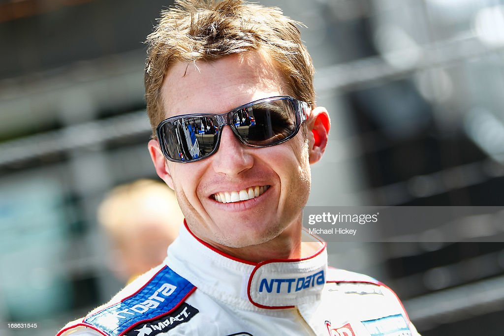 <a gi-track='captionPersonalityLinkClicked' href=/galleries/search?phrase=Ryan+Briscoe&family=editorial&specificpeople=213207 ng-click='$event.stopPropagation()'>Ryan Briscoe</a> of Australia, driver of the #8 NTT Data watches during Indianapolis 500 practice at the Indianapolis Motor Speedway on May 12, 2013 in Indianapolis, Indiana.