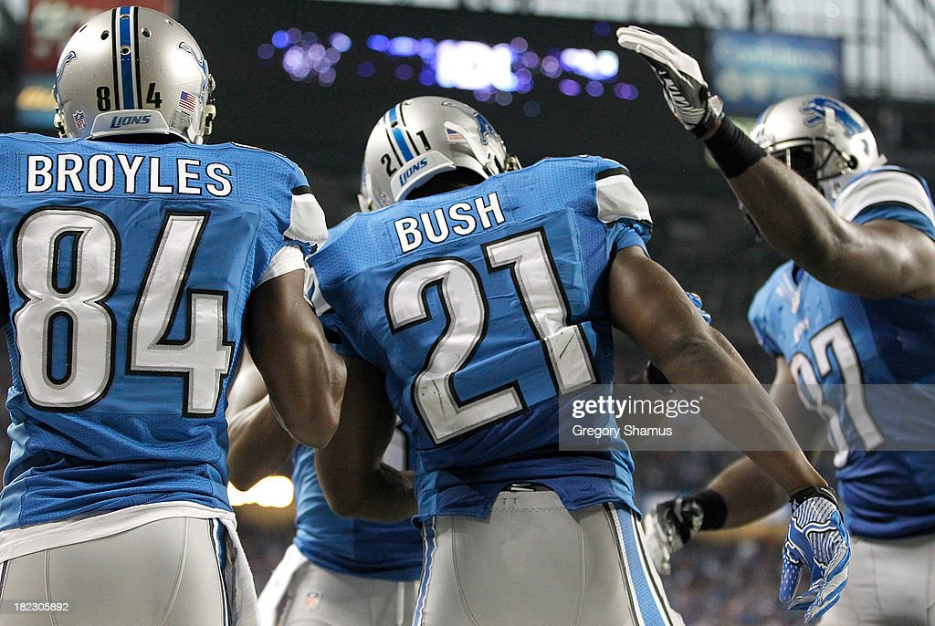 Ryan Broyles #84 and Brandon Pettigrew #87 of the Detroit Lions celebrate with teammate Reggie Bush #21 after Bush's second-quarter touchdown run against the Chicago Bears at Ford Field on September 29, 2013 in Detroit, Michigan.