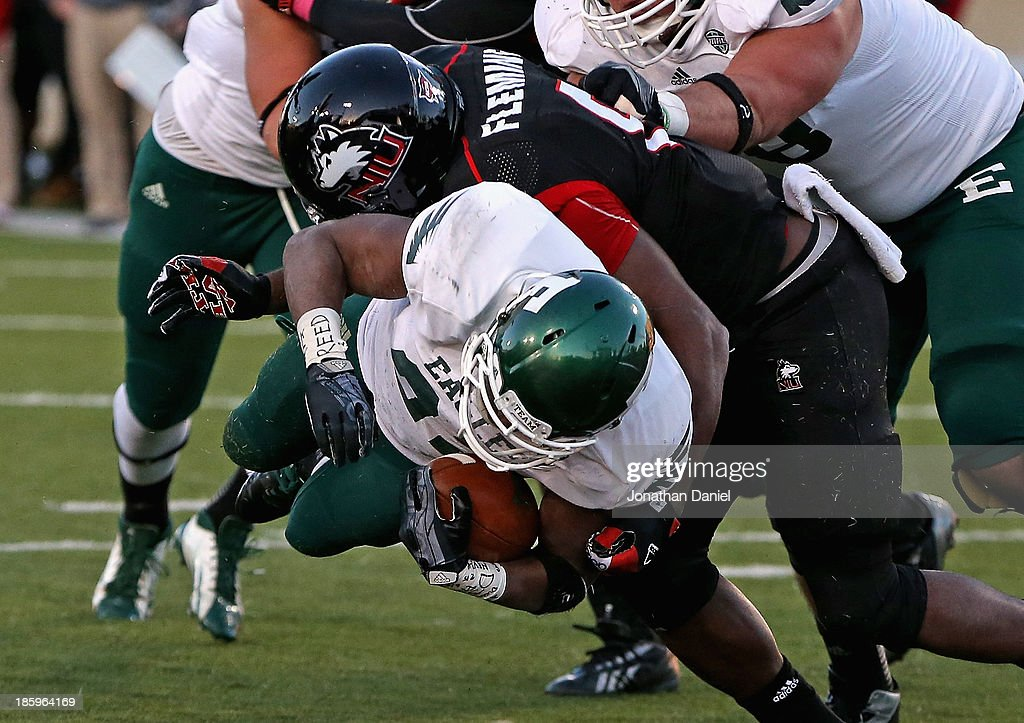 Ryan Brumfield #22 of the Eastern Michigan Eagles dives into the end zone for a touchdown while being hit by Ladell Fleming #8 of the Northern Illinois Huskies at Brigham Field on October 26, 2013 in DeKalb, Illinois. Northern Illinois defeated Eastern Michigan 59-20.