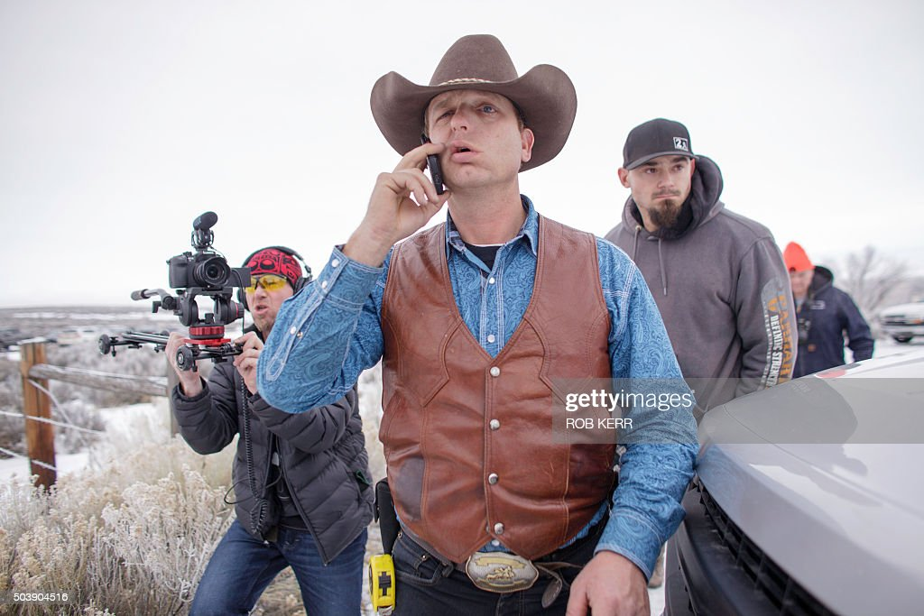 Ryan Bundy speaks on his phone at the occupied Malheur National Wildlife Refuge on the sixth day of the occupation of the federal building in Burns...