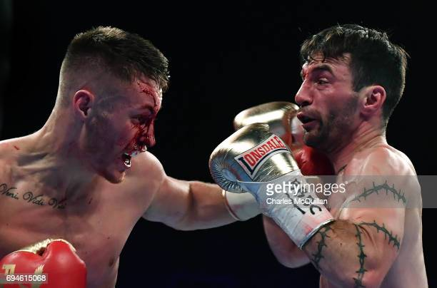 Ryan Burnett of Northern Ireland and Lee Haskins of England during their IBF Bantamweight World Championship bout at the SSE Arena Belfast on June 10...