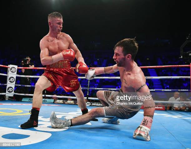 Ryan Burnett of Northern Ireland knocks down Lee Haskins of England during their IBF Bantamweight World Championship bout at the SSE Arena Belfast on...