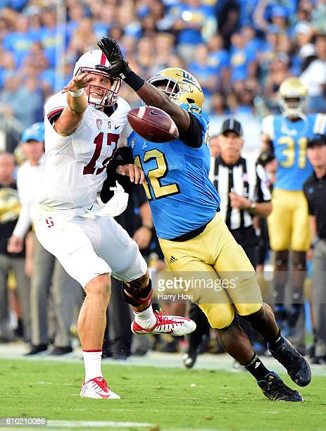 Ryan Burns of the Stanford Cardinal misses a catch as Jayon Brown of the UCLA Bruins is called for pass interference during the second quarter at...