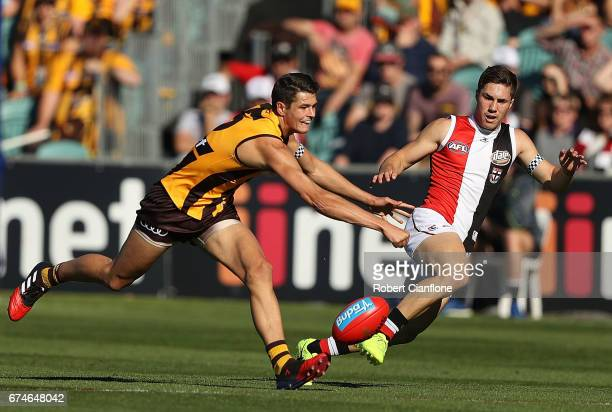 Ryan Burton of the Hawks looks to get the ball during the round six AFL match between the Hawthorn Hawks and the St Kilda Saints at University of...