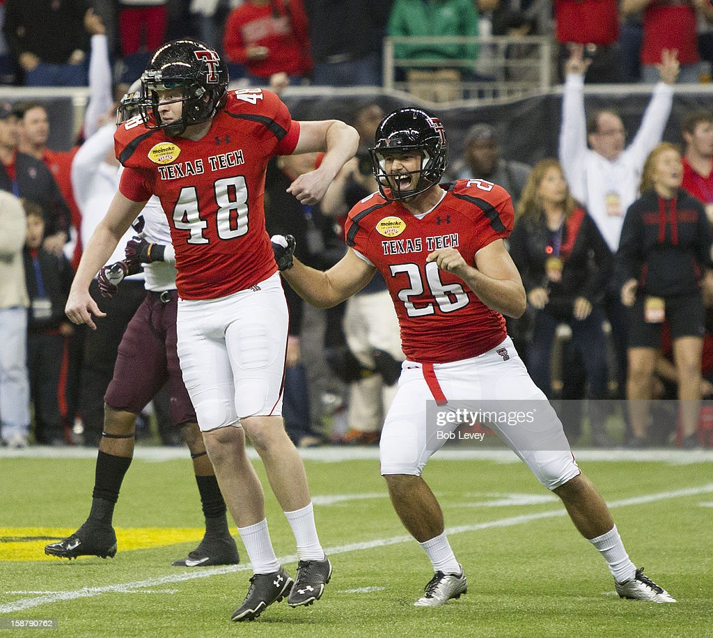 Ryan Bustin #48 of the Texas Tech Red Raiders kicks a 28 yard field goal out of the hold by Ryan Erxleben #26 of the Texas Tech Red Raiders to beat the Minnesota Golden Gophers during the Meineke Car Care of Texas Bowl at Reliant Stadium on December 28, 2012 in Houston, Texas. Texas Tech defeated Minnesota 34-31.